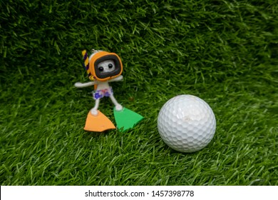 Golf ball with scuba driver caddie to find golf ball if it fall into water
