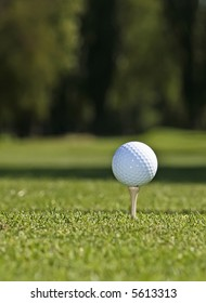 Golf ball set against green grass