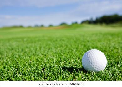 A golf ball sitting on a fairway
