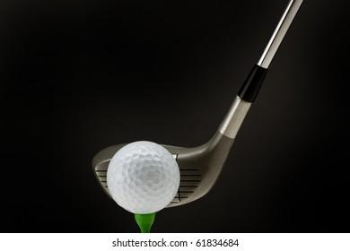 Golf ball tee off isolated