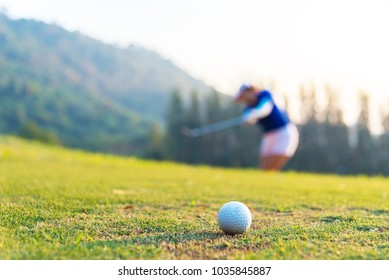 Golf ball and tee on green grass background.Golfers hit sweeping and keep golf course in the summer for relax time