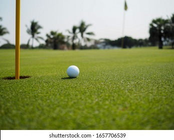 Golf ball that is about to hole