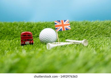Golf ball with Union Jack Flag on green grass for London , England golf