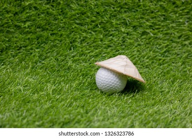 Golf ball with Vietnamese hat for golfing in Vietnam concept