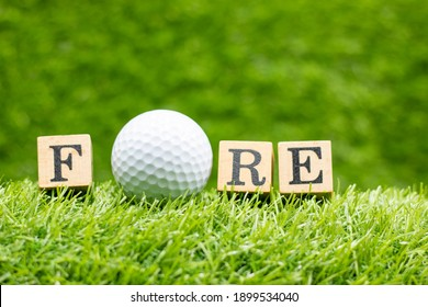 Golf ball with word FORE is on green grass background