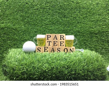 Golf ball with word par tee season and glasses of beer are on green grass for party concept - Shutterstock ID 1983515651