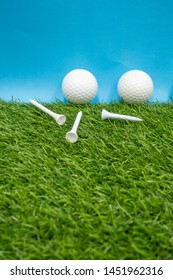 Golf balls are on blue background