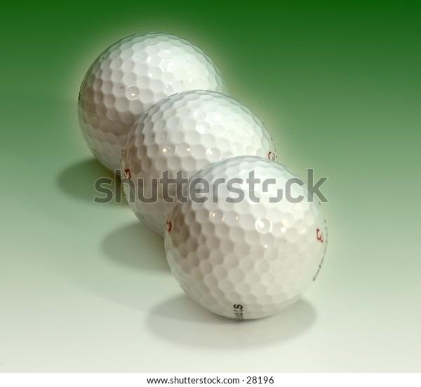 Golf balls on a green background.