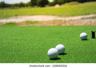 golf balls on the green grass