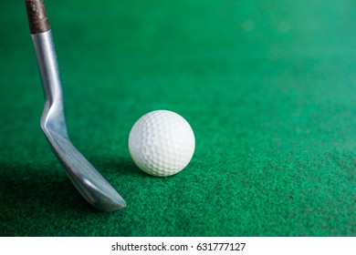 Golf balls on the green lawn.