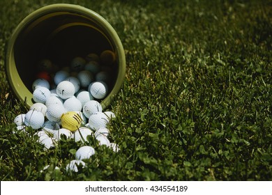 golf balls spilling out of bucket