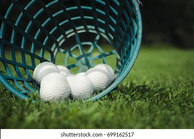 Golf balls spilling out of bucket