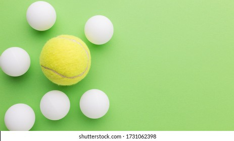 Golf balls and tennis ball with copy-space. Outstanding, choice and difference concept. Being unique and individuality.