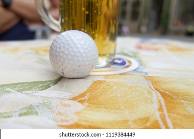 Golf with beer are on table in clubhouse