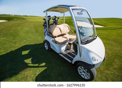 Golf buggy, auto interior and exterior, no people, leather interior, green grass and nice weather