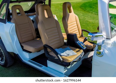Golf buggy, auto interior and exterior, no people, leather interior, green grass, sunny day