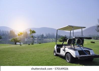golf car on green grass Mountain backdrop