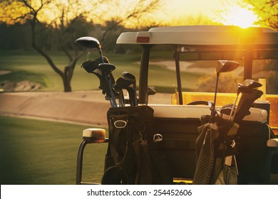 Golf cart - beautiful sunset overlooking gold course