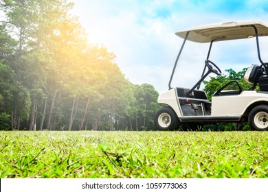 Golf cart or car club on fairway in beautiful golf course for golfer playing and diving on layout in tournament compettition on blue sky and cloud of daytime. This course many tree on mountain
