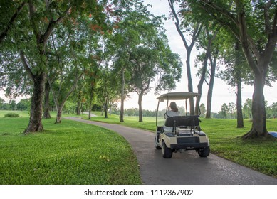 Golf cart or car on golf course. Looking see beautiful layout and fairway.