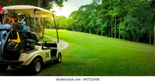 Golf cart or car on golf course. Looking see beautiful layout and fairway. Beautiful Road for cart to drive. Morning sky and cloud. Equipment and bag are put in ready for golfer to player in field