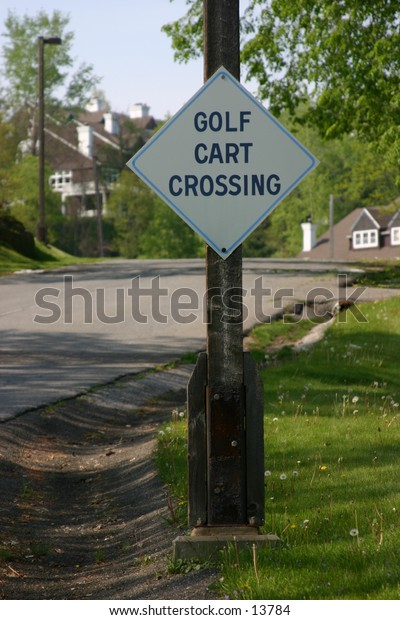 'golf cart crossing' sign