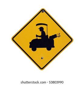 Golf cart crossing sign in a affluent desert community.