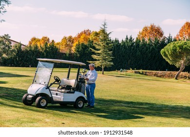 Golf cart on the course with colorful background