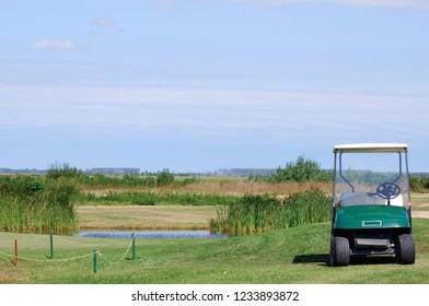 golf cart on golf course landscape
