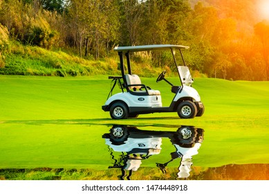 A golf cart park on green grass with golf course view,refection golf cart with sun sky background