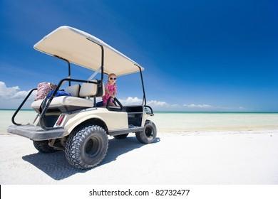 Golf cart at tropical white sand beach in Holbox Mexico