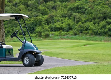 Golf carts in golf course.