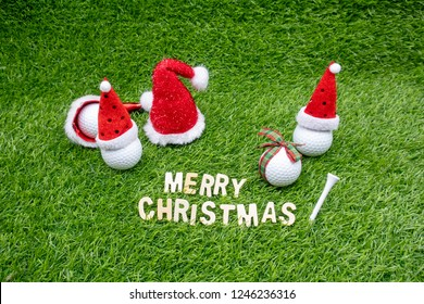 Golf Christmas with golf ball and Santa Claus hat on green grass , Merry Christmas to golfer
