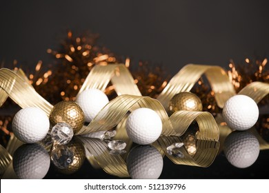 Golf Christmas with golden and white balls on black background