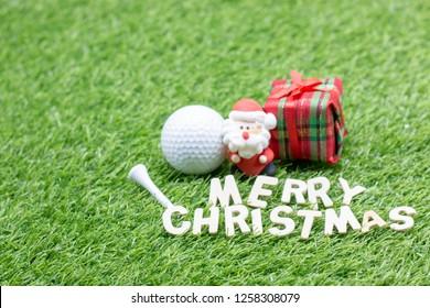 Golf Christmas with Santa and golf ball on green grass