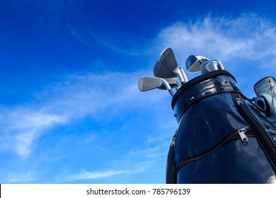 Golf club in bag with blue sky background.