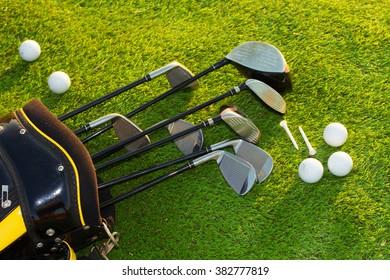 Golf club in bag on grass
