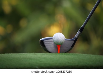 golf club and golf ball close up in grass field with sunset. Golf ball close up in golf coures at Thailand