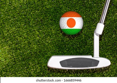 A golf club and a ball with flag Niger during a golf game.
