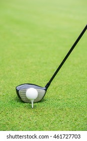 Golf club and ball in grass, tee off