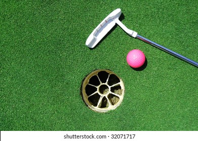Golf club, golf ball, hole