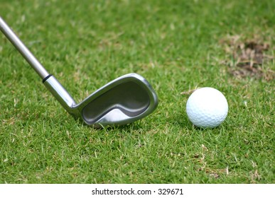 golf club with ball next to it