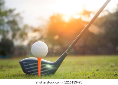 Golf club and golf ball on green grass ready to play.Morning sunshine with fresh feeling.Popular sports of people around the world that help keep you healthy and enjoy.
