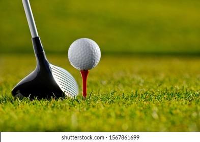 Golf club and ball on tee