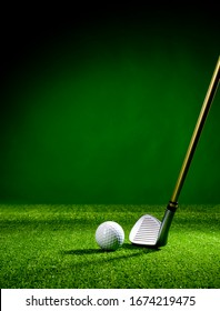 Golf club and golf ball on the turf