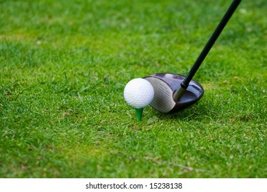 Golf club and ball in teeing position