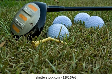 golf club with balls and broken tees