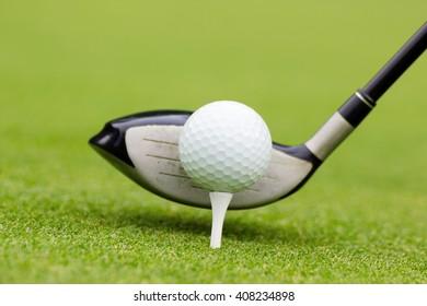 Golf club behind the ball on the fairway
