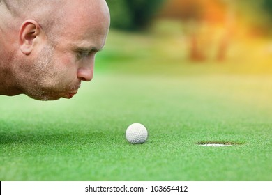 Golf club: golfer concentrating on the 18th hole