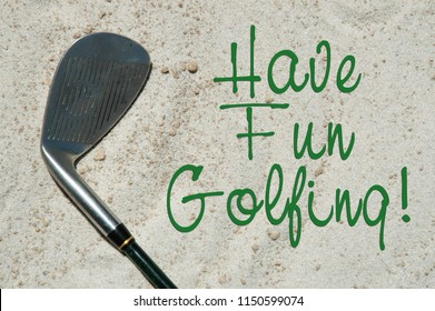 """Golf club laying in the sand. """"Have fun golfing"""" greeting card concept."""
